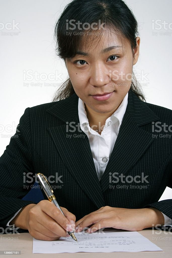 Asian Businesswoman Writting royalty-free stock photo