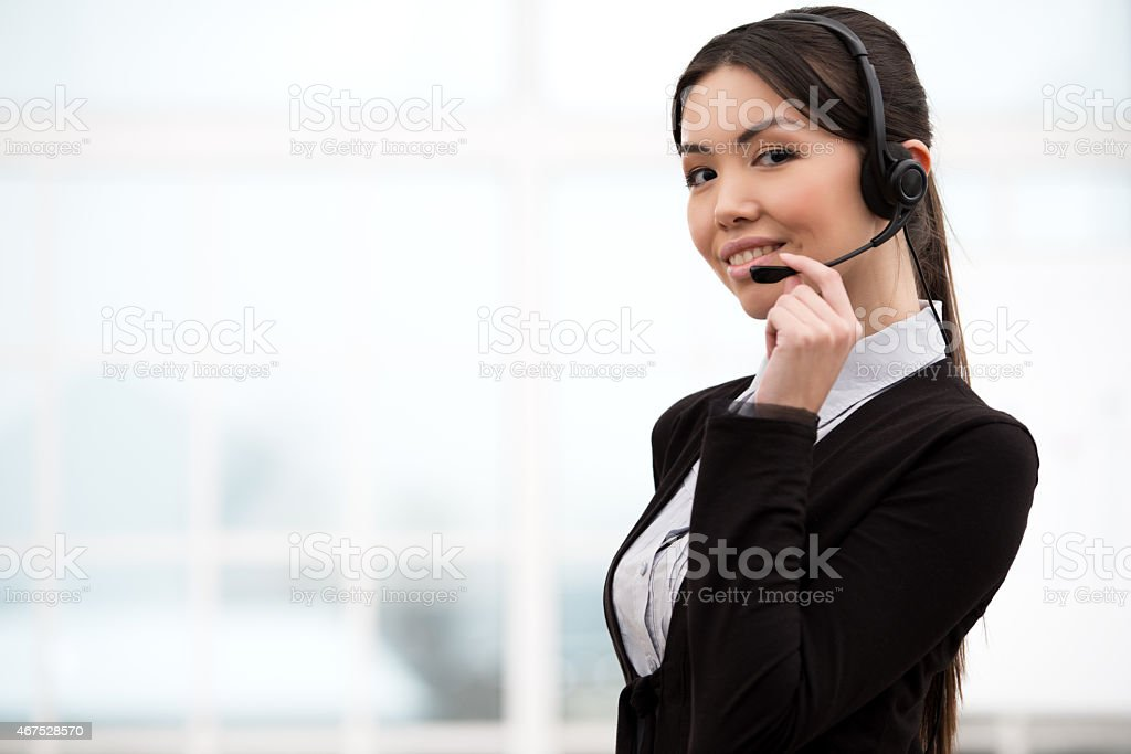 Asian call center female operator looking at camera stock photo