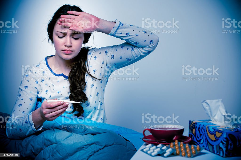 Asian caucasian woman with flu and feaver in bed stock photo