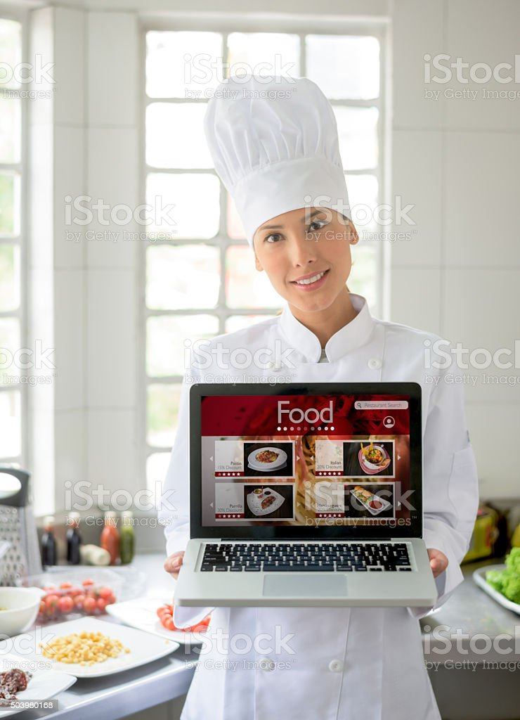 Asian chef holding an online menu stock photo