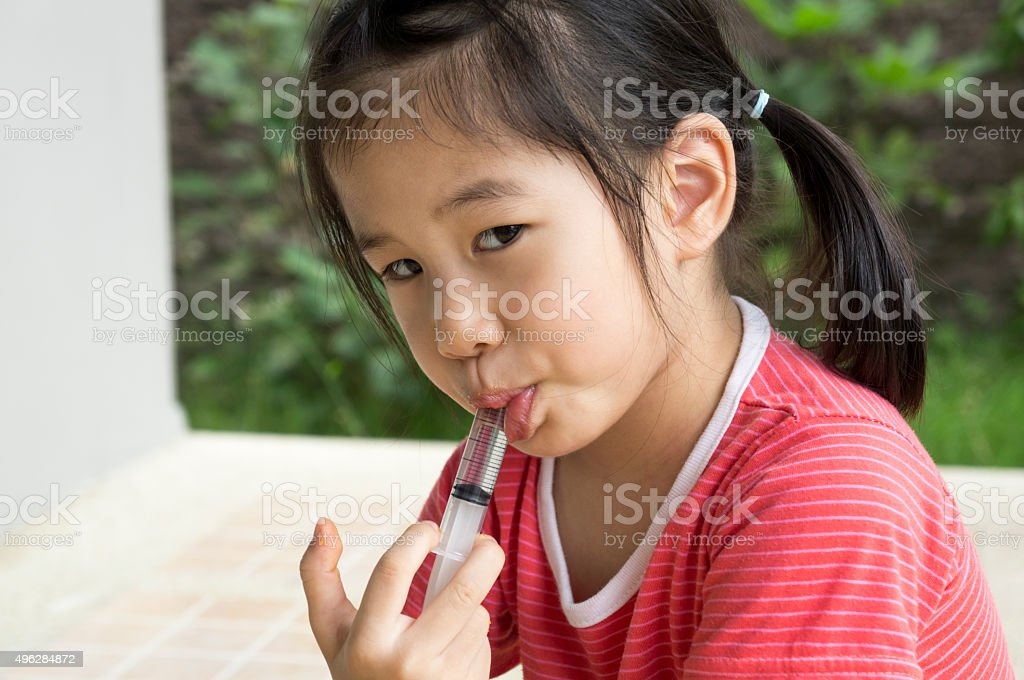 Asian child girl childhood medicine cold fever concept stock photo