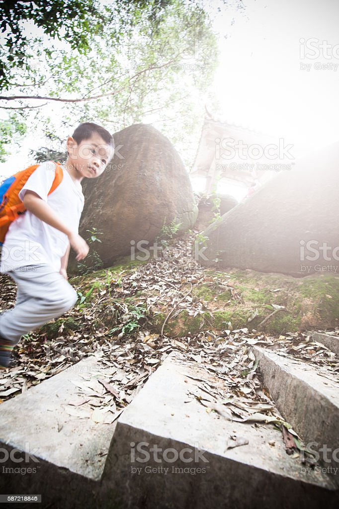 Asian child hiking in the mountain stock photo
