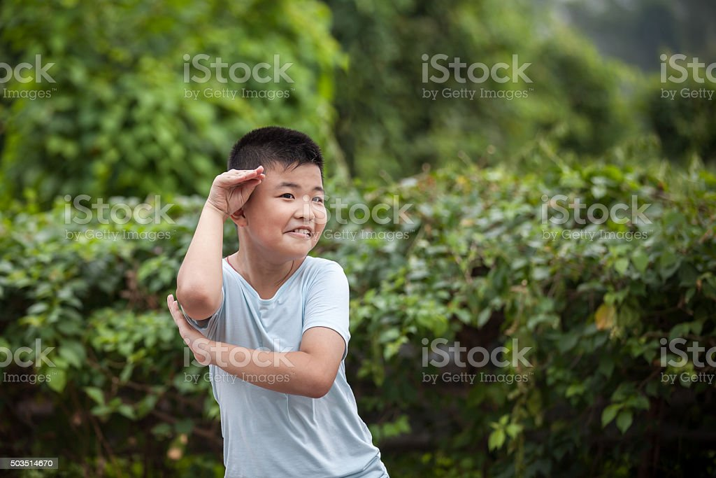 Asian child imitate monkey stock photo