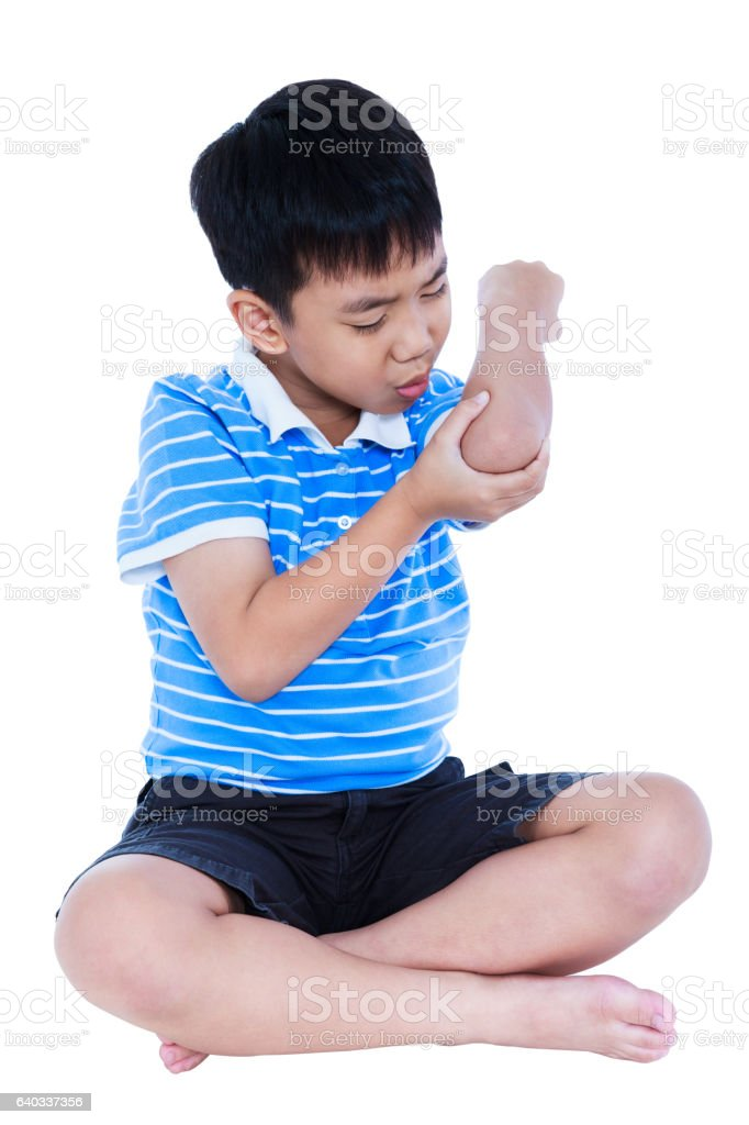 Asian child injured at elbow. Isolated on white background. stock photo