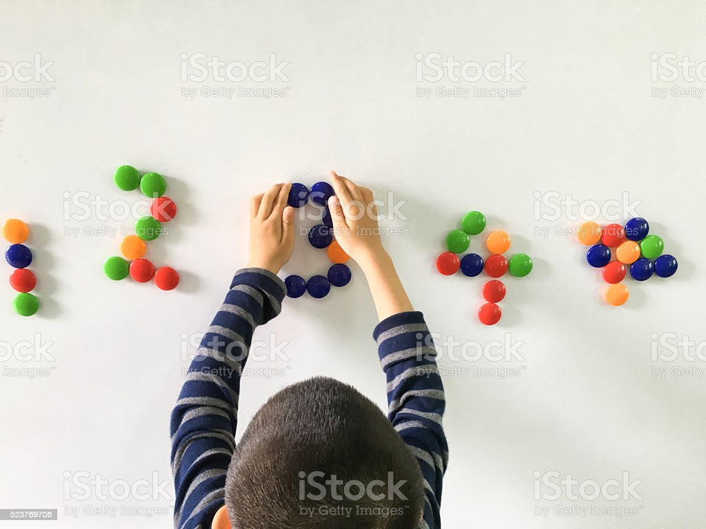 Asian Child Learning Numbers stock photo