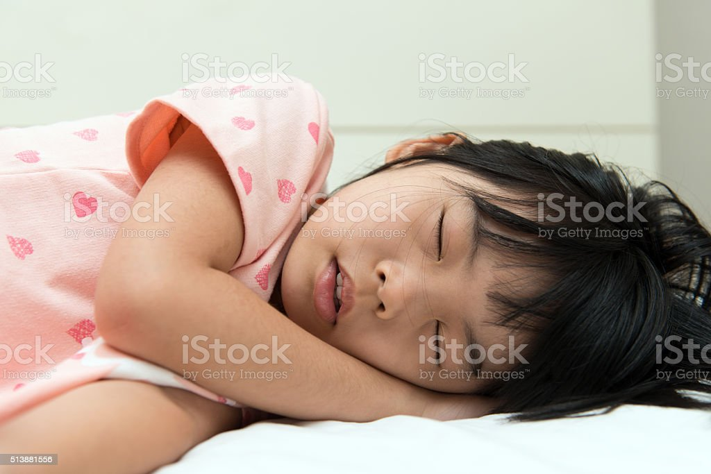 Asian child sleeping stock photo