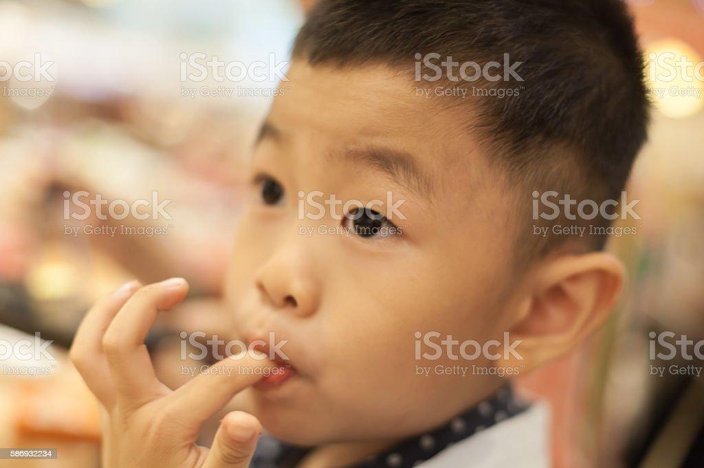 Asian child suck finger stock photo