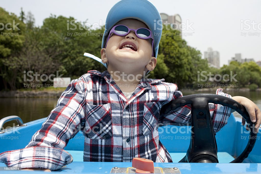 Asian chinese babyboy  boating in the lake royalty-free stock photo