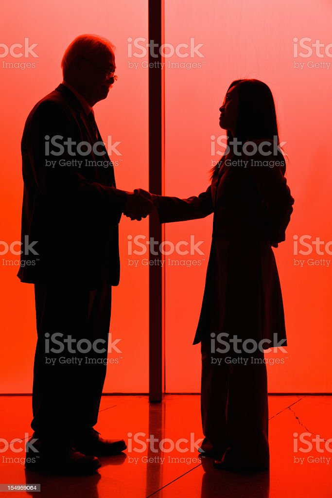 Asian Chinese Business Handshake between Generations Sihouette royalty-free stock photo