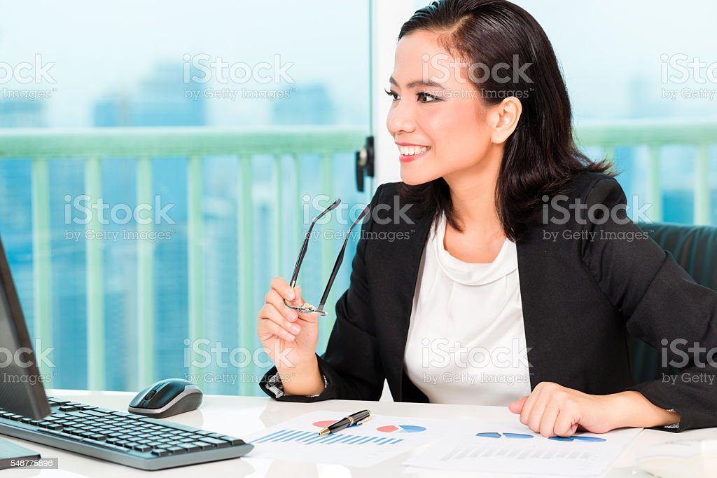 Asian Chinese businesswoman in office stock photo