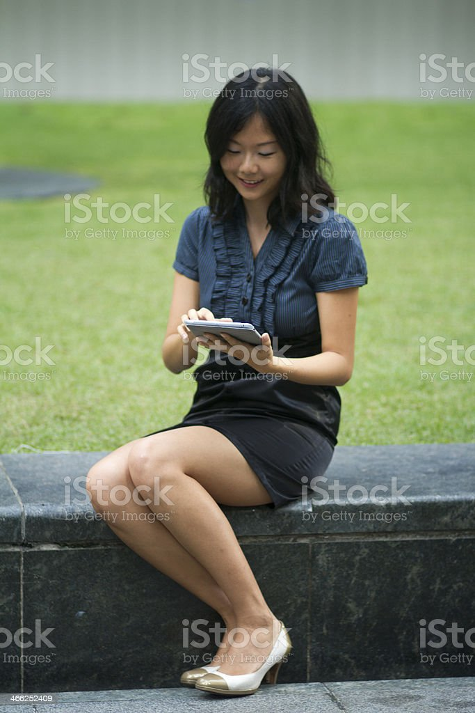 Asian Chinese businesswoman using a digital tablet royalty-free stock photo