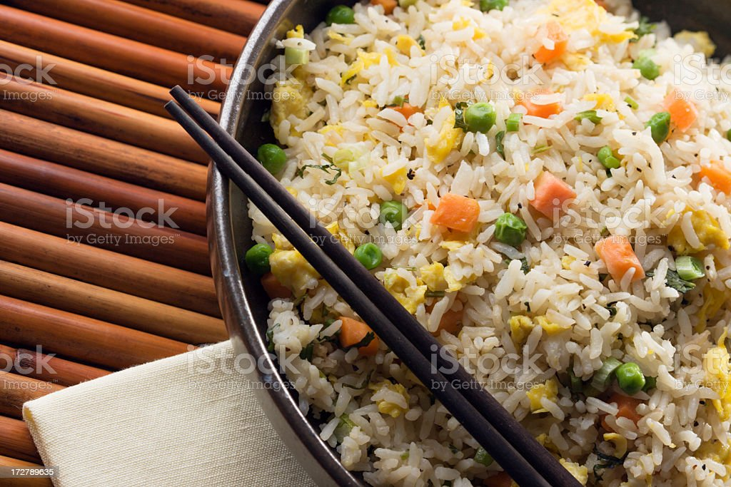 Asian Chinese Fried Rice with Vegetable and Egg with Chopsticks royalty-free stock photo