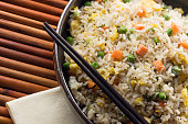 Asian Chinese Fried Rice with Vegetable and Egg with Chopsticks