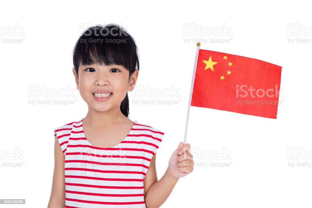 Asian chinese little girl holding Chinese Flag stock photo