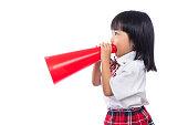 Asian Chinese little girl holding retro megaphone