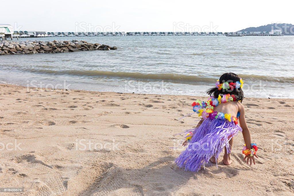 Asian Chinese little girl in hawaiian costume Looks Far Away stock photo