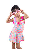 Asian Chinese little girl portrait wearing goggles and swimsuit
