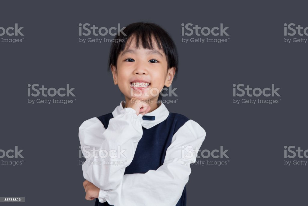 Asian Chinese little girl standing in front of blackboard stock photo