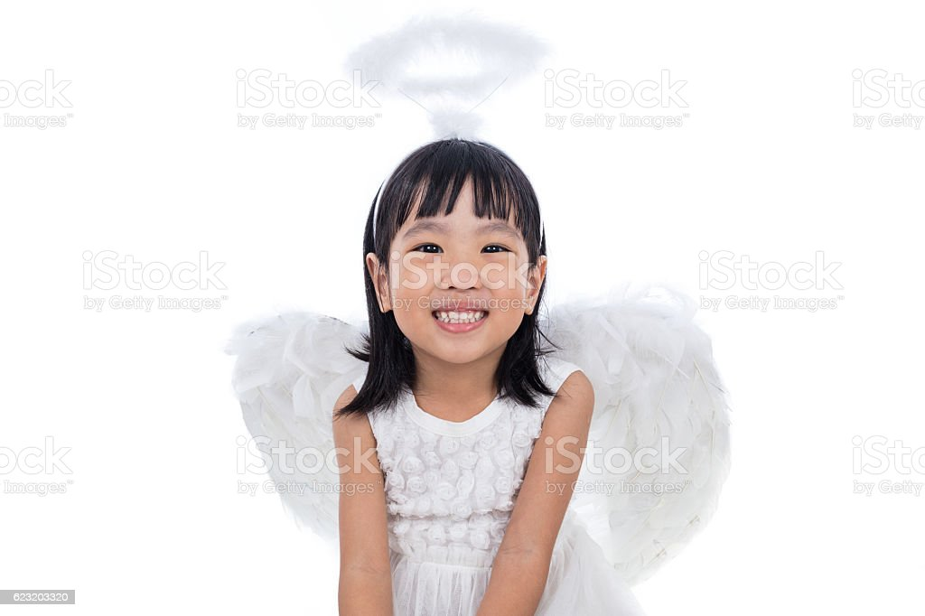 Asian Chinese little girl wearing angle costume stock photo