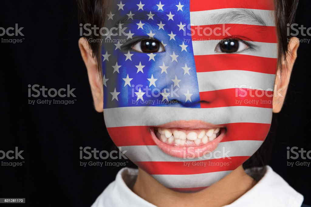 Asian chinese little girl with American flag on face stock photo