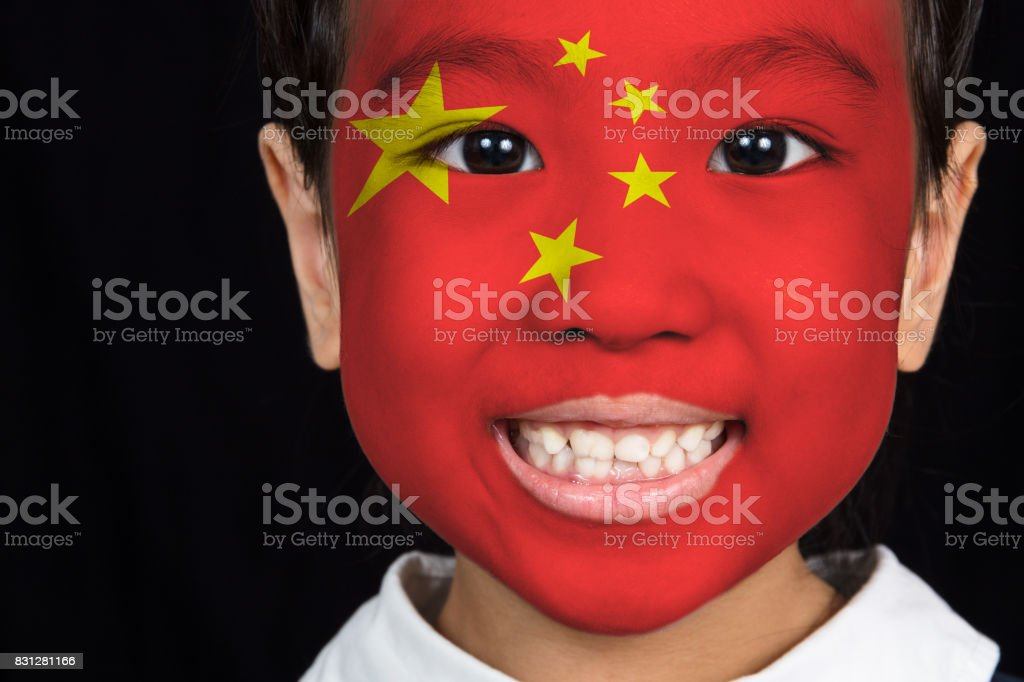 Asian chinese little girl with Chinese flag on face stock photo