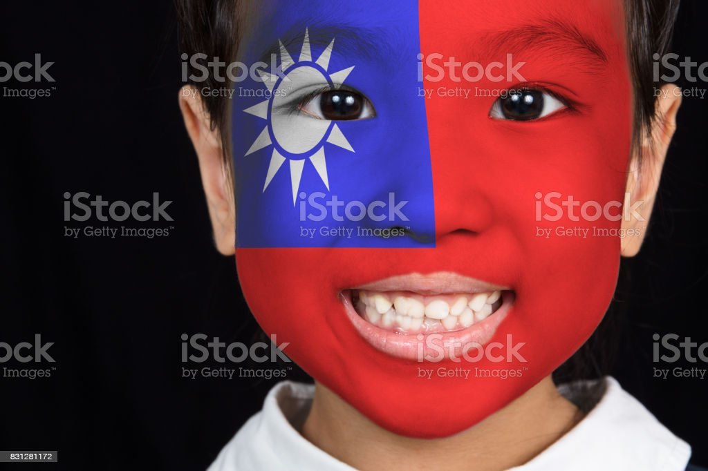 Asian chinese little girl with Taiwan flag on face stock photo