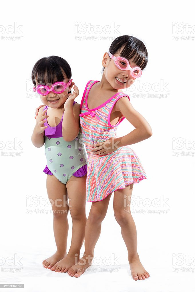 Asian Chinese little Sister portrait wearing goggles and swimsui stock photo