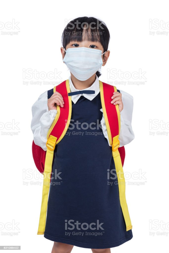 Asian Chinese school girl with school bag and wearing mask stock photo