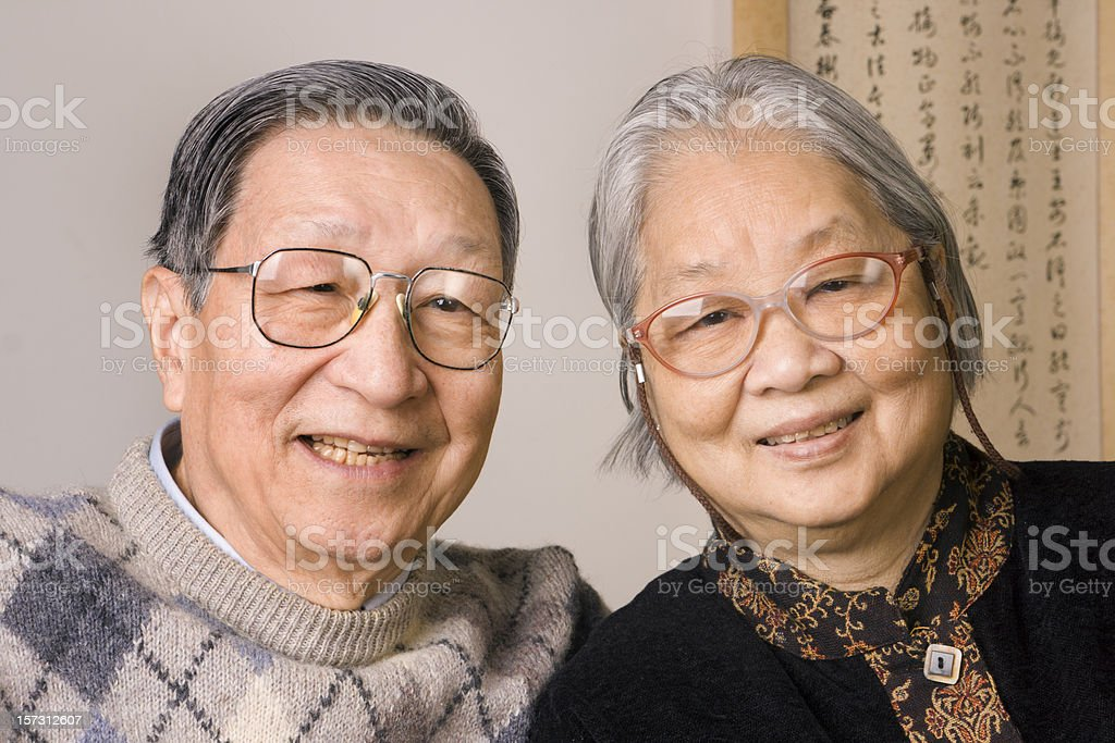Asian Chinese Senior Couple, Happy, Smiling Retired Grandparents Lovingly Together royalty-free stock photo