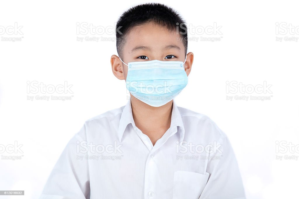 Asian Chinese Student Boy In Uniform Wearing Mask stock photo