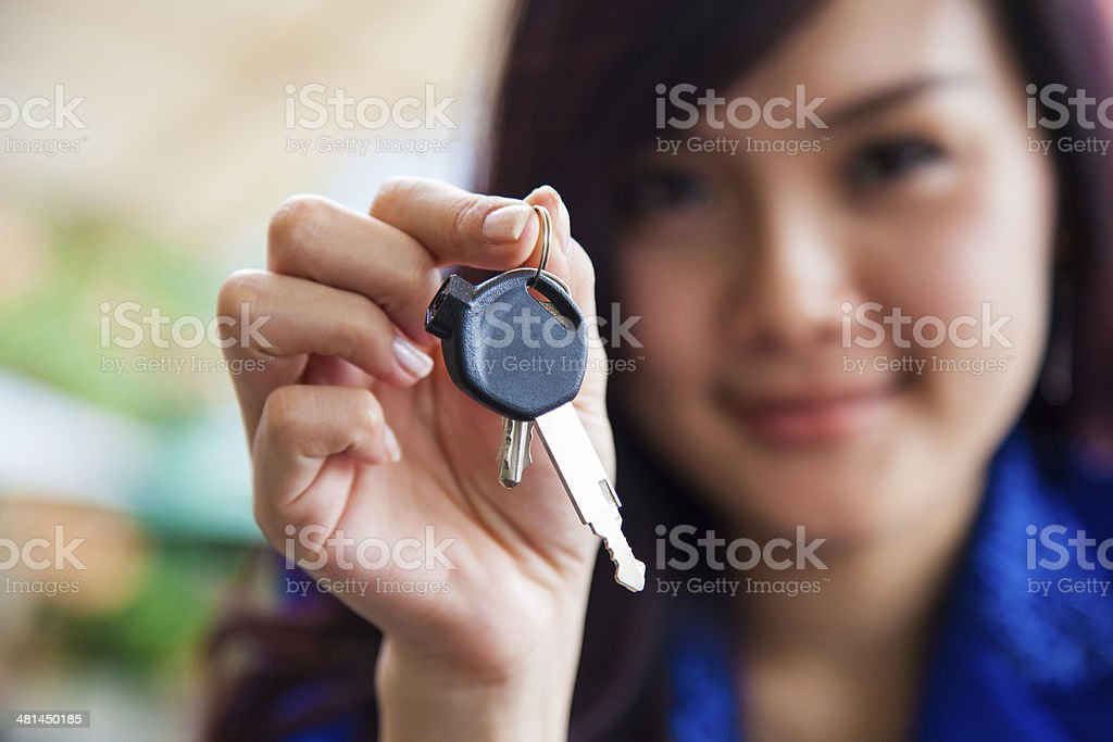 Asian Chinese Woman holding new home keys stock photo