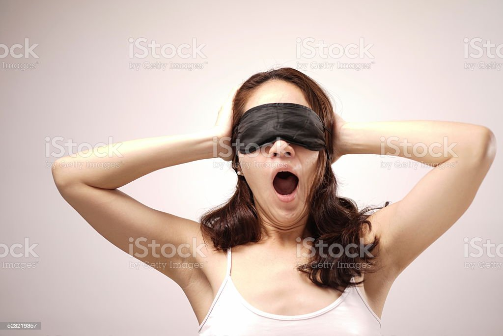 Asian chinese woman with her eye cover stock photo
