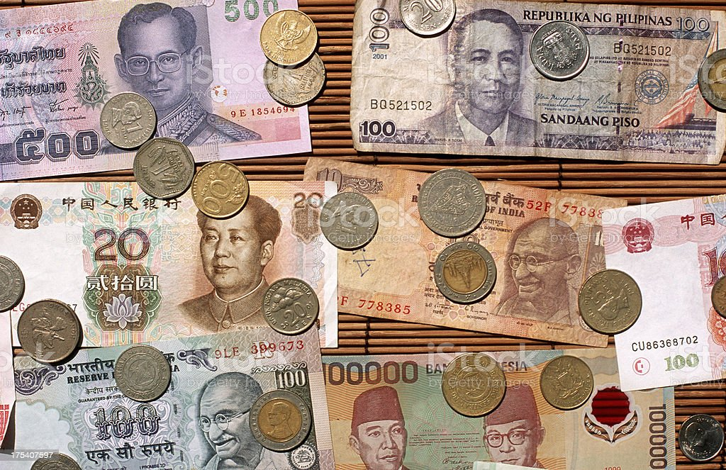 Asian coins and currency. royalty-free stock photo