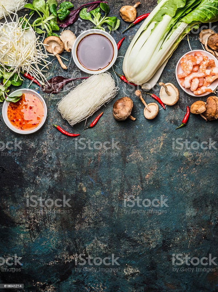 Asian cooking ingredients on dark background, top view stock photo