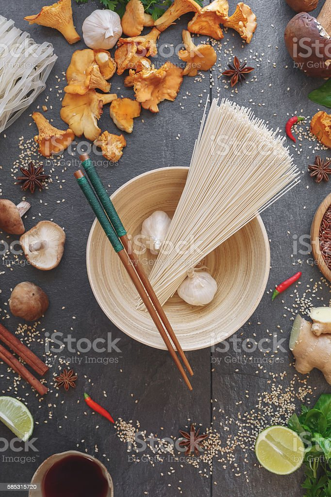 Asian cooking ingredients with chopsticks stock photo