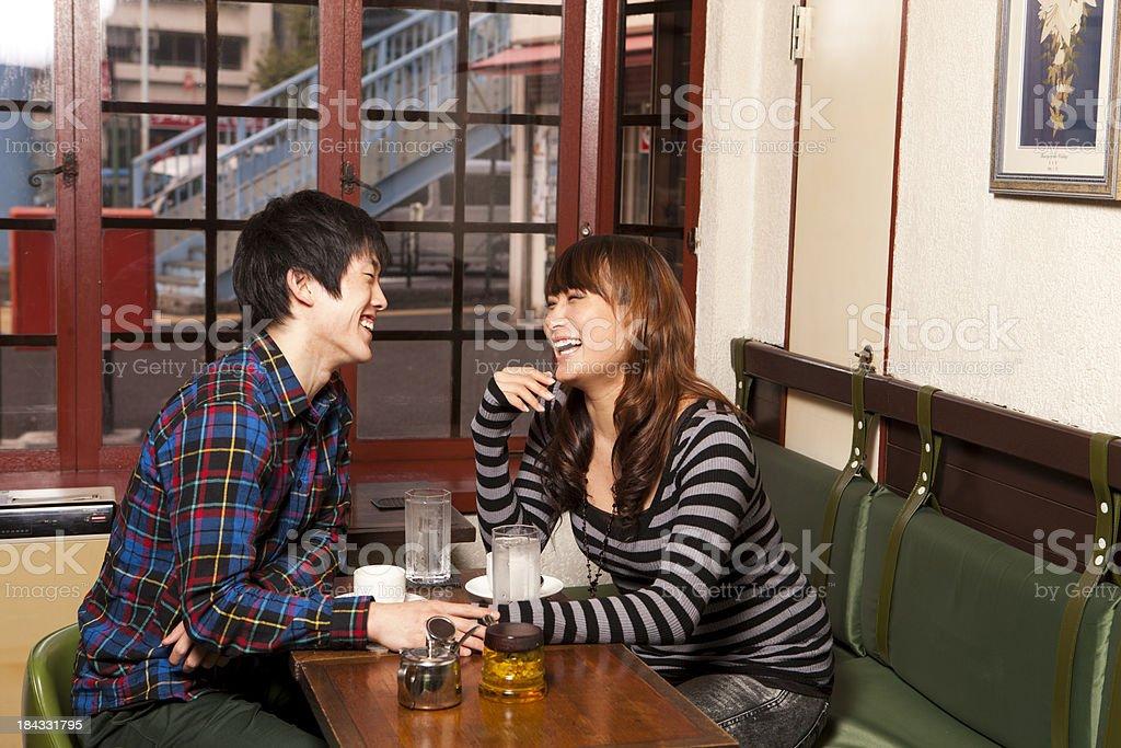 Asian Couple Enjoying Tea royalty-free stock photo