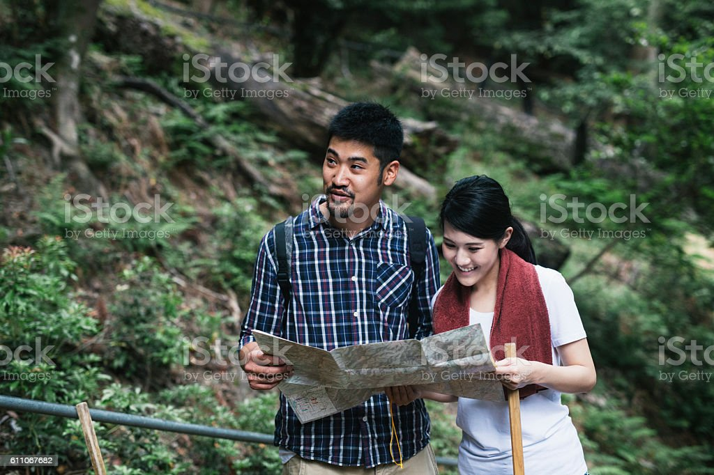 Asian Couple Exploring the Map stock photo