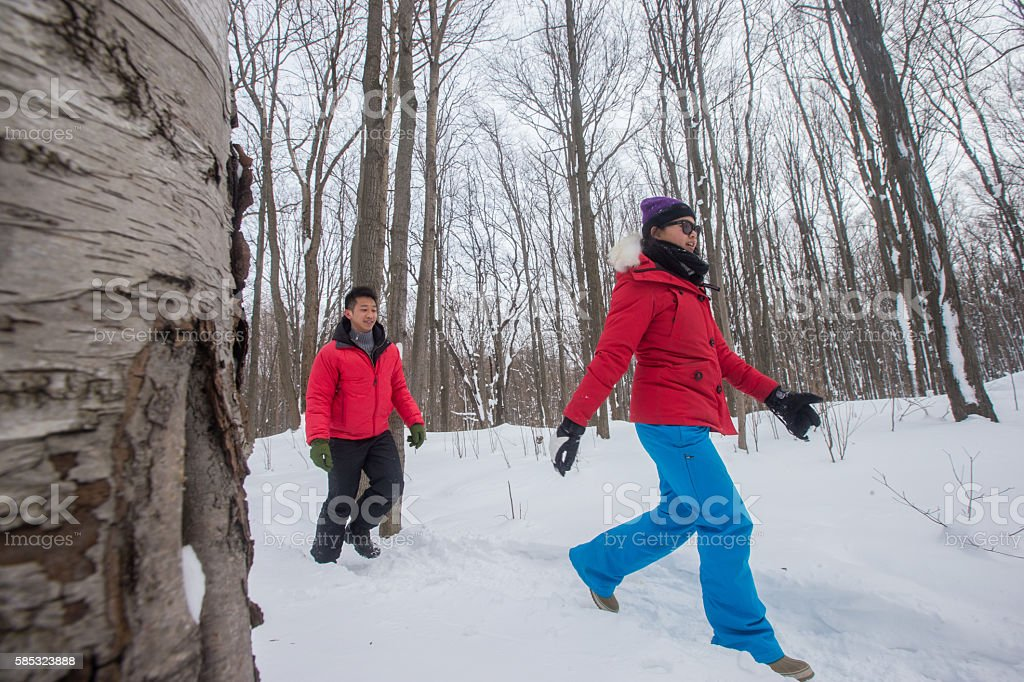 Asian couple hiking in the winter stock photo