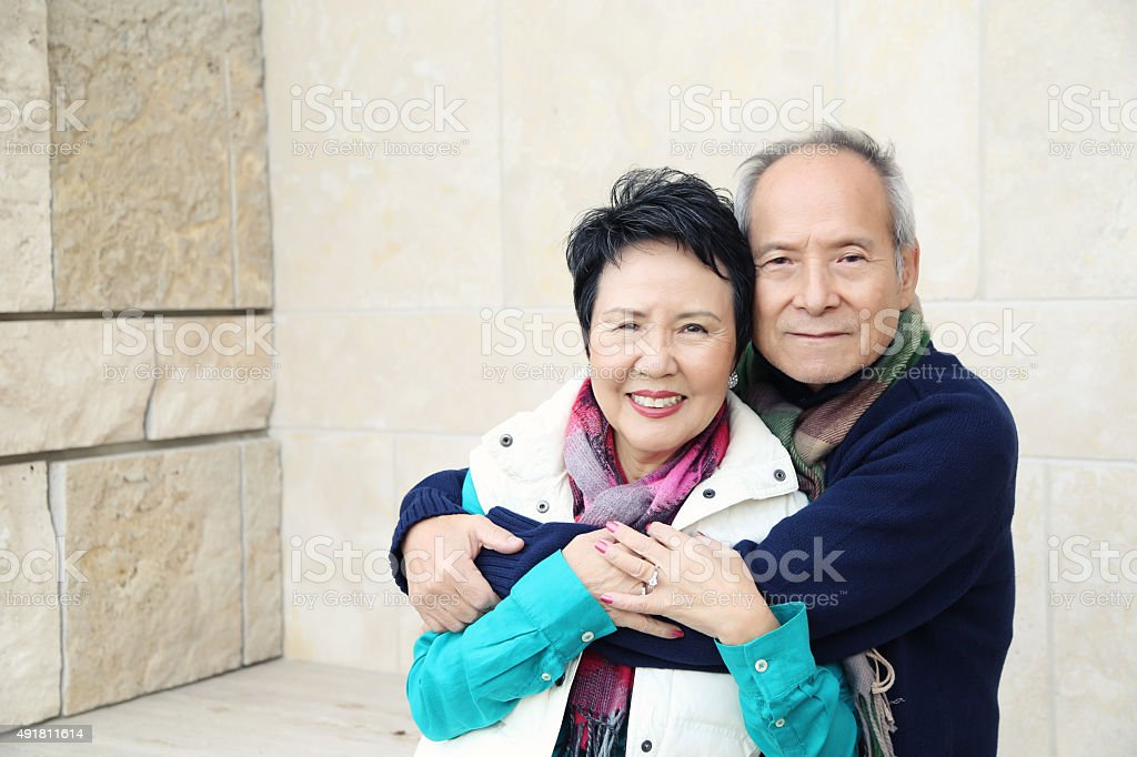 Asian Couple in Embrace stock photo