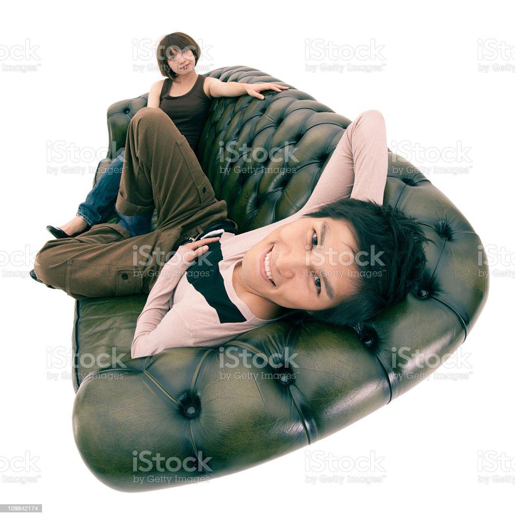 Asian couple on sofa stock photo