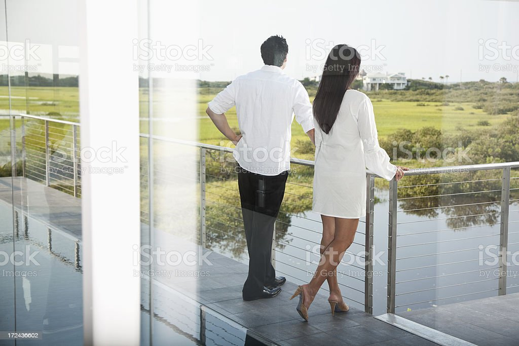 Asian couple on terrace overlooking marsh royalty-free stock photo