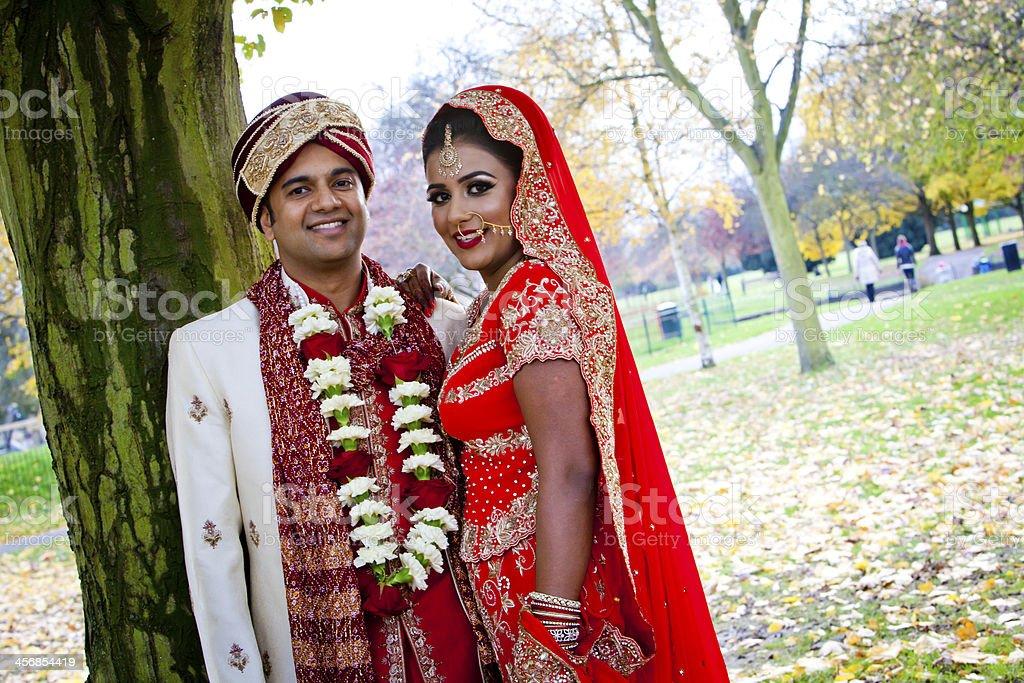 Asian couple on their wedding day stock photo