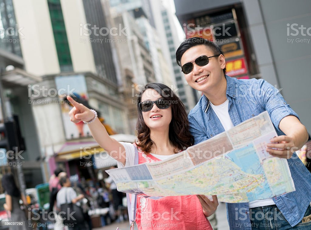 Asian couple sightseeing in Hong Kong stock photo