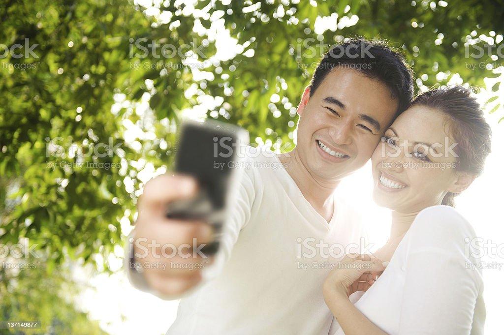 Asian Couple Taking Photographs royalty-free stock photo