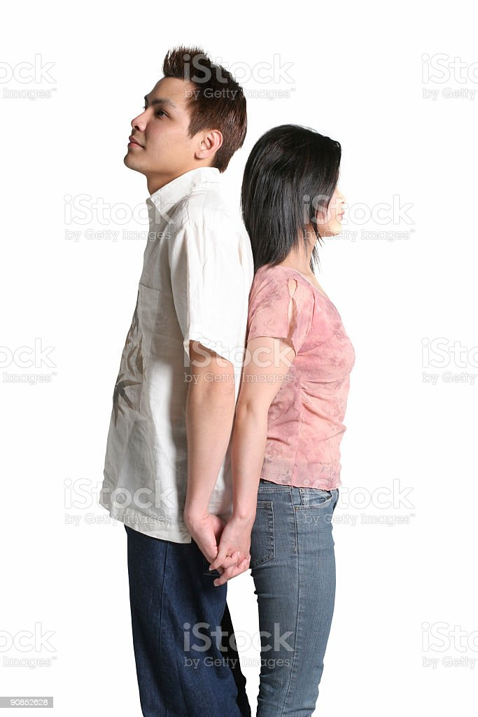 Asian couple with their backs to each other royalty-free stock photo