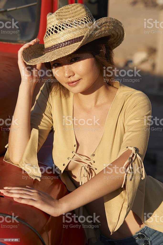 Asian cowgirl red truck royalty-free stock photo