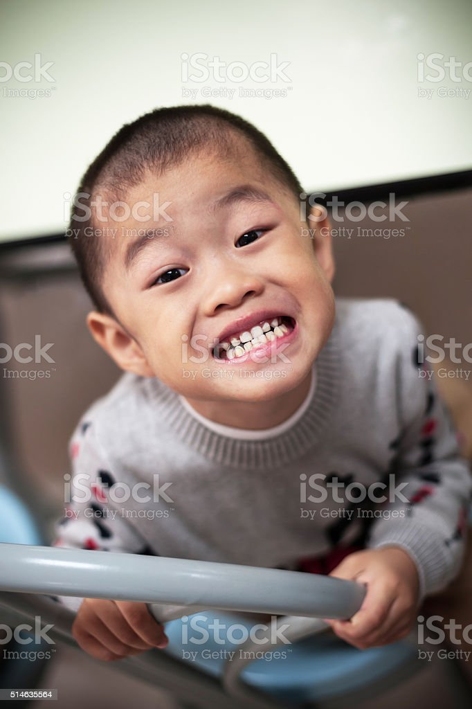 Asian crazy child Bared teeth stock photo