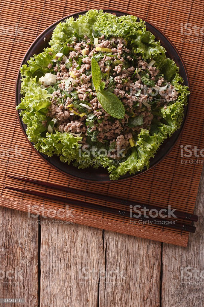 Asian cuisine: salad of minced meat with herbs. vertical stock photo