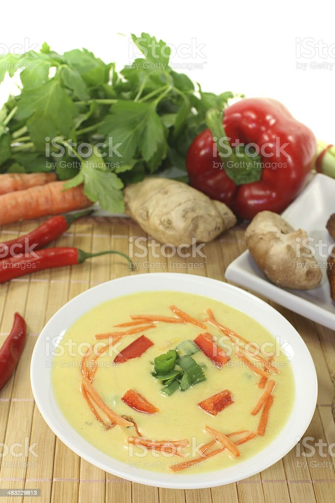 Asian Curry Soup with chicken and carrots stock photo