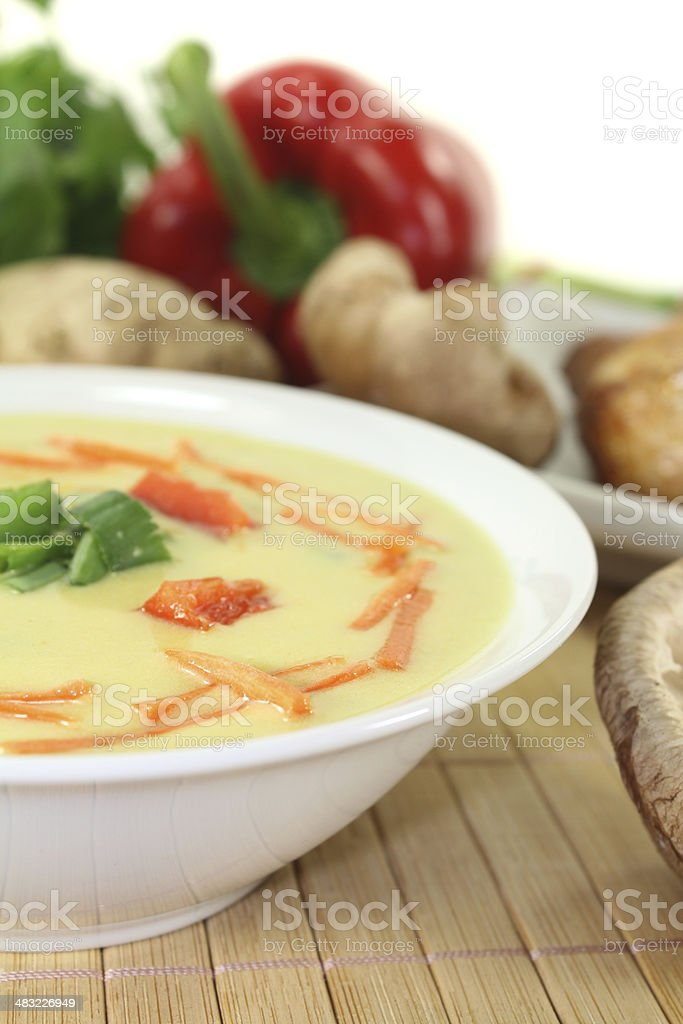Asian Curry Soup with chicken stock photo